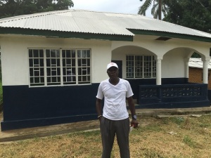 Counselor Ahmad Bangura in front of the building to be used for our mobile clinic.